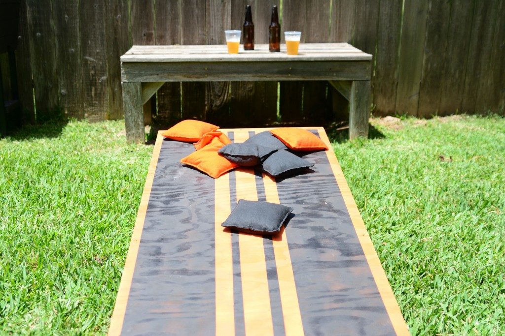 A custom colored cornhole gameboard