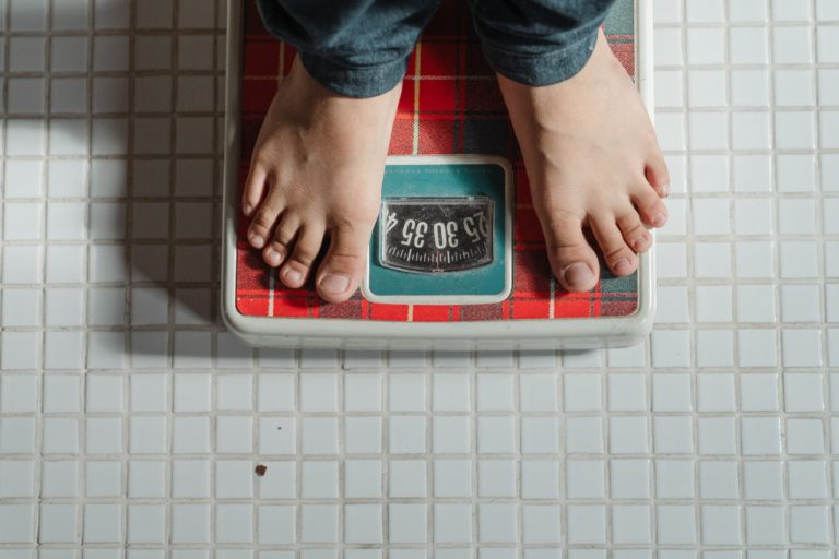 person on weighing scale